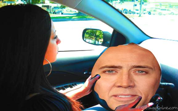 steering wheel replaced with nicolas cage