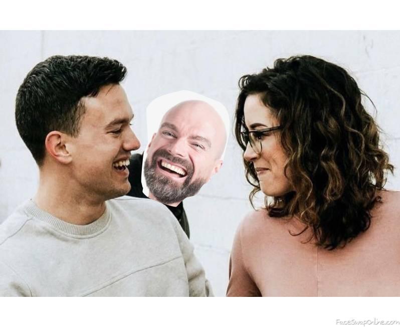 Bald guy photobombs an boyfriend/girlfriend moment