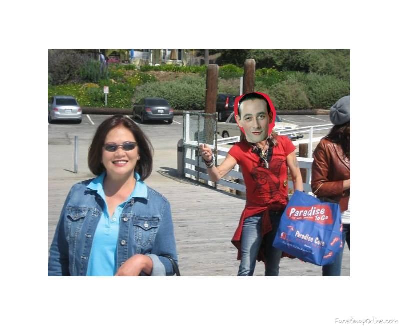 Pee Wee Herman photo bombing a lady's picture