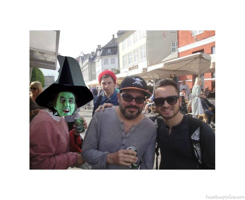 "Wicked Witch of The West photo bombs an picture of the ""Guys""."